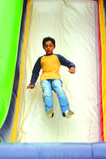 Kaylan Sheth, 9, of Mount Washington was airborne as he came down the inflatable slide.