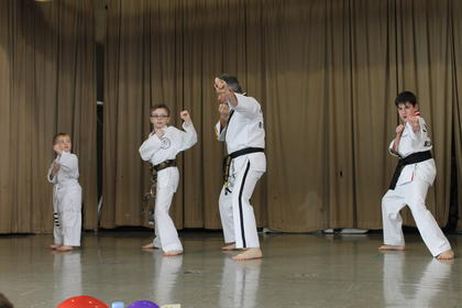 Students from Sallee's Taekwondo perform a demonstration on the main stage during the event.