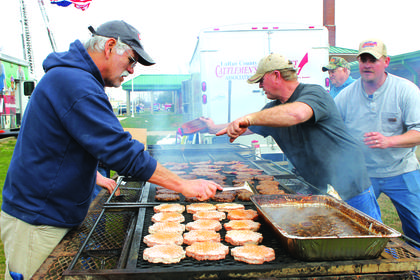 Members of the LaRue County Cattlemen's Association grilled  burgers with all the fixins outside of the event.