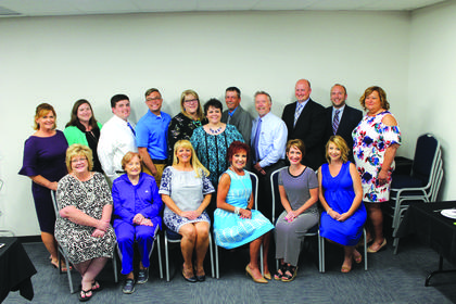 The LaRue County Chamber of Commerce 2018-19 Board of Directors are (front row) Allison Shepherd, Nina Cundiff, Executive Director Sandy Kidd, Pam Stephens, Katie McDowell, and Shanna Dobson (back row) Patty Holbert, Lora Setters Lamb, Gilbert Cox, Parker Smith, Natalie Boyd, Chamber President Marsha Duncan, Josh Singer, Stan Mullins, Nathan Highbaugh, Daniel Carpenter and Paula Woods. Not pictured is Tammy Reesor.