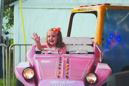 Chloe Walker drove around the Merry Go Round on the first day of the LaRue County Fair.