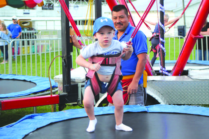 Marc Edlin was trying new things at the LaRue County Fair as he was learning how to jump on the trampoline.