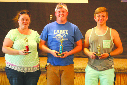 The winners of the adult karaoke contest are pictured from left: Katy Shelton (second place), Cam Lasley (first place) and Austin Hawkins (third place)