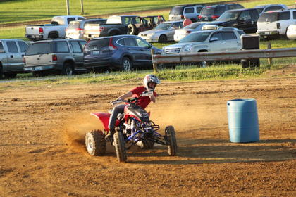 The ATV rodeo included several contests included timed laps around several barrels.