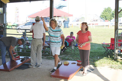 Several people came out for the cornhole tournament at the fair.