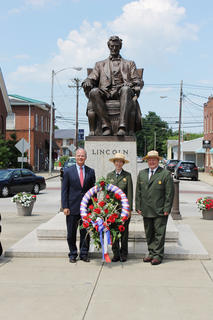 Congressman Brett Guthrie, Mammoth Cave National Park Superintendent Sarah Craighead and Abraham Lincoln Birthplace National Historic Park Superintendent Jay Grass at the Wreath Laying Ceremony held on the Square in downtown Hodgenville.