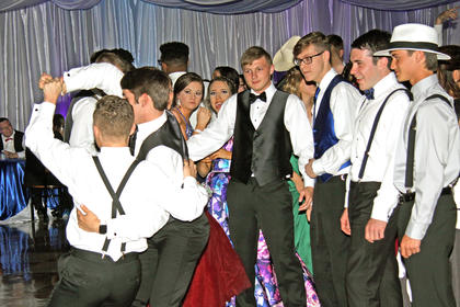 A group of guys dances the night away at LC Prom 2019.