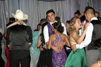 Juniors and Seniors enjoy a sweet moment while slow dancing.