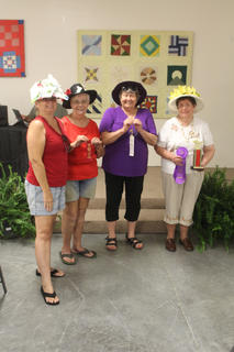 There were five entries in the Derby Hat Contest held at the Senior Citizen's Day.  From the left are: Mary Ann Lavigne, Dixie Lawson, Sharon Hornback, and Lou Downs who won first place. Not pictured is Snookie Morrison.