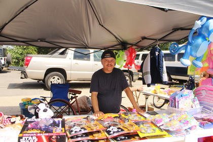 Richard Curtsinger of Hodgenville mans his crafts booth, proceeds from which are going to missions.