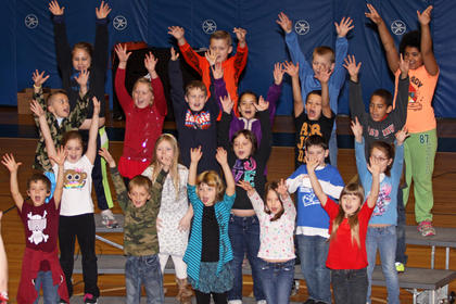 """Alan Thomas' second grade class sings """"Rockin' Around the Christmas Tree."""" Front from left,   Colby Garland, Chase Pellman, Amy Johnson, Ellie Barbour, Kelsea Baker; second row, Alison Toher, Lexi Wheeler, Peyton Foster, Bradley Laughner, Kelly Logsdon; third row, Will Ray, Cammie Allen, Ashlin Bailey, Lenayah Andrews, Anthony Whitmer, Nayland English; back, Maci Druen, Cutter Boley, Tom Shelton and Alina Honaker."""