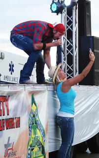 Lindsey Bell took a selfie with country artist J.D. Shelburne at Saturday's AGstravaganza. Shelburne performed a finale concert for the LaRue County Farm Bureau event.