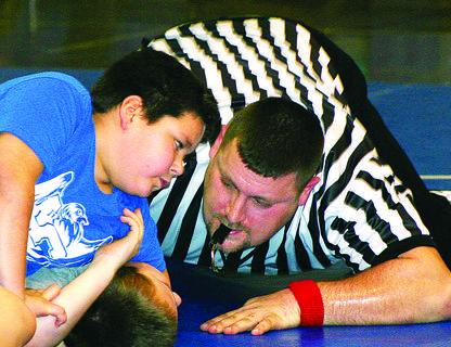 Conner Lambert hoped he was getting close to a pin in a Friday match. He looked at referee Brience Willian for signs of his progress.