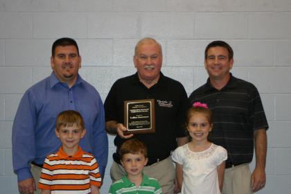 "Alex LaRue accepted the award for Outstanding Business/Professional Person; on behalf of his father, James ""Jim"" LaRue, founder of LaRue Insurance. Alex's sons, Jack, left, and Aaron, accompanied him to accept the award. Grandchildren in front are Jameson LaRue, Clay LaRue and Audrey LaRue."