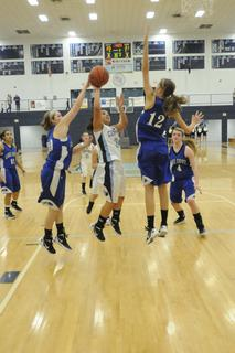 LaRue's Miranda Hornback and Alisha Durbin block the shot attempt of Central Hardin's Alexis Johnson.