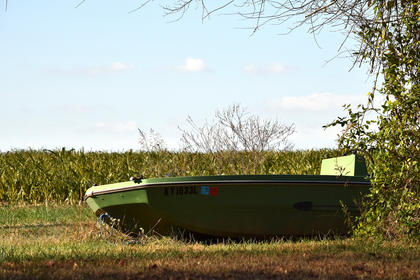 "I don't remember exactly which road this boat was on, but it was ""docked"" in the grass and reminded me of a quote from a movie ""Karate Kid 2,"" Karate teacher Mr. Miyagi tells a reluctant student why it's important to return to school: Ambition with out knowledge is like a boat on dry land."