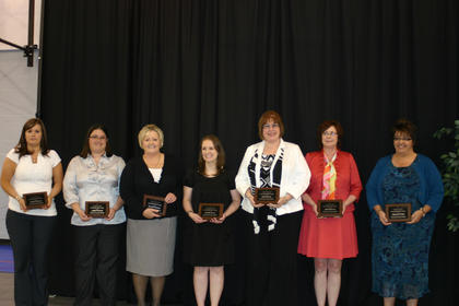 The 2013 Leadership LaRue class held their plaques in honor of their graduation. This year's class includes from left, Kelly Clemons, Angel French, Sarah Graham, Krista Levee, Gina Lewis, Beth Roberts and Melanie Wells.