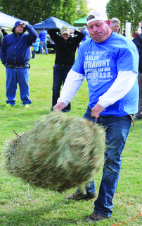 Bill Thomas won the hay bale toss during the Pioneer Games on Saturday.