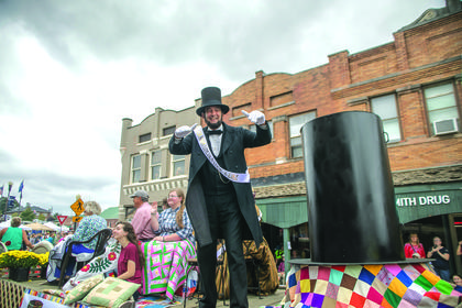Ron Carley gives a thumbs up on a float during the Lincoln Days parade. Carley was this year's Lincoln Look-A-Like winner. photo by Melanie Wells