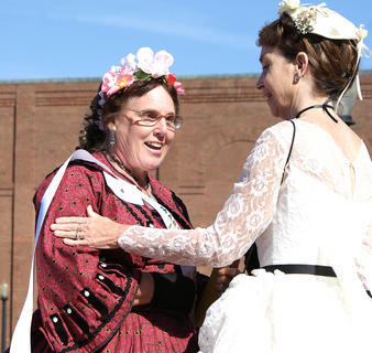 Linda Lou Brewer of Central City was named winner of the Mary Todd Lincoln Look-Alike Contest. Runner-up Debbie Grise of Russellville helped her with the sash.