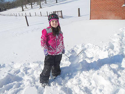 Madison Glass, 7, daughter of BJ and Megan Glass of Buffalo, loves the snow and was excited to build her own snowman. Madison is a 2nd grader at ALES.