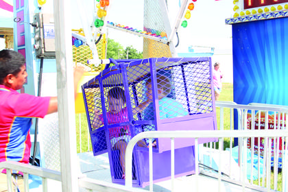 Sophie Bishop rode the mini Ferris wheel with her twin brother Kaden during Kids Day at the Fair.