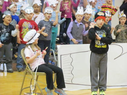 """Students Saydee Darst, played the role of Baba, and Hayden Gividen played Nicky in """"The Mitten."""" Students in the background are from Mrs. Ray and Mrs. A. Williams' class."""