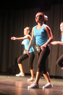 Montana Metcalf performs the group section of a fitness routine during the Dinstinguished Young Women program Saturday.