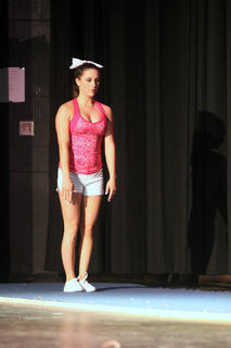 Montana Metcalf takes a deep breath before beginning a gymnastics routine for the talent portion of the Distinguished Young Women program.