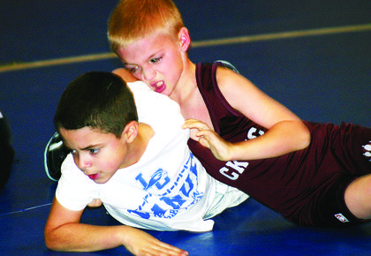 Gavin Ferguson, bottom, tries to break away from his Campbellsville opponent.