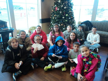 Fifth graders at Abraham Lincoln Elementary spread holiday greetings to residents at Sunrise Manor. Each fifth grader wrote messages and signed Christmas cards and then several students and their siblings personally delivered the cards. The students were accompanied by their parents, grandparents, and teachers, Heather Hynes, Karlotta Cecil, Todd Rogers. Front from left, Tristin Brown, Biven Turner, Daniel Snodgrass, Madison Wilmoth,Titus Snodgrass, Ellah Pruitt; back, Isaiah Pruitt, Brendan Keith, Aimee Hornback, Kameron Knox, Keaton Knox and Tristen Locke.
