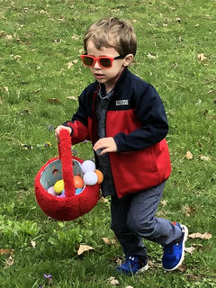 Kase Rock, 3, of Hodgenville rushes to beat other egg hunters.