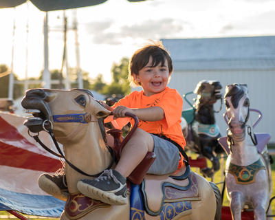 Mason Baker, 5, of Hodgenville is all smiles as he rode the merry-go-round.