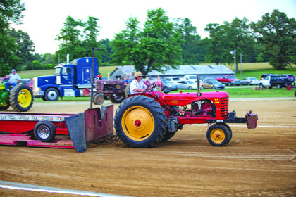 Frank Hornback of Hodgenville is pictured participating in the tractor pull on his 44 Massey Harris .