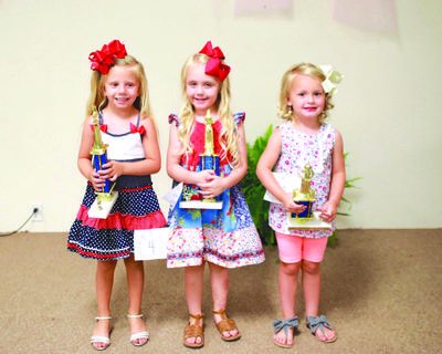 Tiny Miss From left to right Kensley Melson first place. Parents are Jonathan and Amanda Melson. Allie Hope Roberts first runner up. Parents are Ben and Angela Roberts. Kinley Grace second runner up.