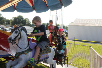 Pictured from left on the merry-go round are Jayden Gusler, 6, of Hodgenville; Kenleigh Grace Milby, 3, of Hodgenville and Kayla Calarco, 7, of Mt. Sherman.