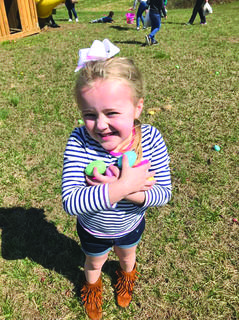 Kinzleigh Hack, 6, of Hodgenville holds on tight to her eggs.