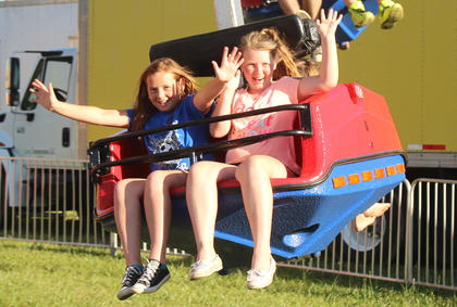 Amaris Lane, 10 and Allie Cecil, 10, both of Buffalo, were all smiles while riding a ride at the fair.