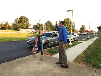 Seventh grader Lily Norman is pictured high fiving LCMS Assistant Principal James Slaven.