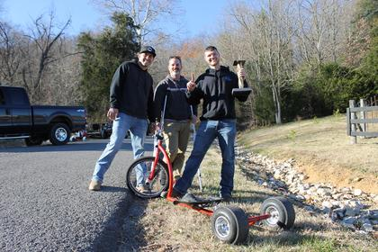 Event founders Levi Woolridge and Jason Newton stand with Kurt Edelen of New Hope, KY this year's winner.