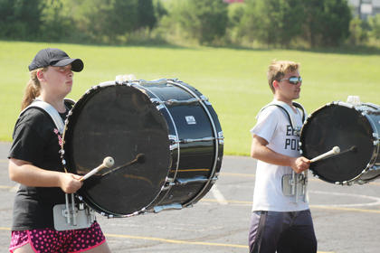 Pictured from left are bass drum players Brianna Posey and T.J. Relo.