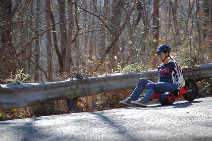 Kiersta Tucker of Elizabethtown rode her bike backwards at Sunday's event.