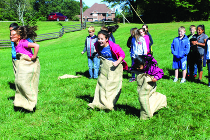 Walnut Hill Elementary students from Mrs. Spaw's class participate in a sack race during the Walk Through Lincoln's Life event.
