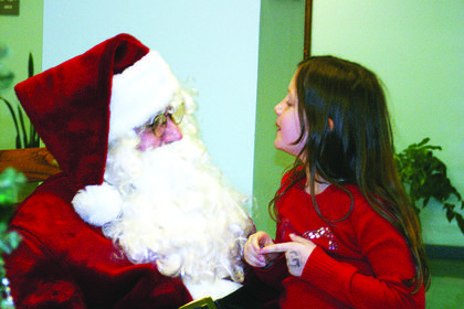 Hannah Boggs told Santa Claus she'd like a Nintendo DS game system for Christmas. Hannah and several other children visited with the Jolly Old Elf, played by Police Chief Steve Johnson, Saturday at Hodgenville Civic Center.