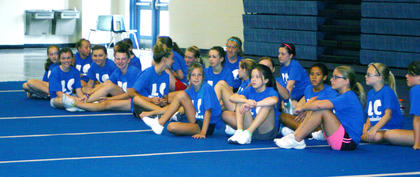 A group of 24 girls listen to their coaches as they get ready to begin their day at cheer camp, held at LaRue County Middle School.