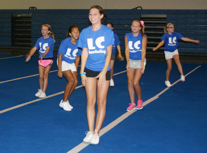 From left, Madison Eads, Kylee Thurman, Rachel Armes, Katelynn Lafollette and Chloe Sandidge perform during a routine at their summer camp. The camp was held from 9 a.m.-5 p.m. each day and was at LaRue County Middle School.