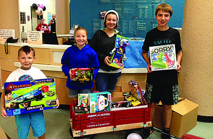 The student council at Saint Catherine Academy in New Haven held a toy drive for Kosair Children's Hospital. Joe Charles, Anna K., Alex and Davis O'Bryan delivered the toys to Kosair on June 13.