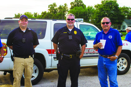 Hodgenville Police Officer Daniel Highbaugh, Hodgenville Police Chief Marcus Jackson, and Hodgenville Mayor Jim Phelps enjoyed the celebration.