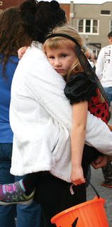 Grace Lynn Wayman, 5, rested in her mom's arms.