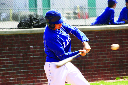 Travis Wallace, an eighth-grader, took a swing in a recent Hawks' baseball game.